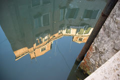 Venetian house reflecting in water Royalty Free Stock Photo
