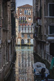 Venetian house reflects in canal. Cityscape of Venice town, Italy Stock Photo