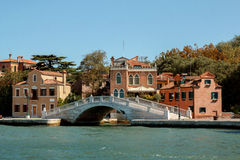 Venetian houses and bridge Italy. View from sea Stock Photo