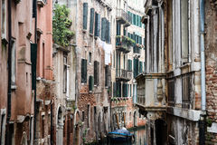 Venetian houses. One of the many small canals, surrounded by historic houses with faded flair and signs of decay Royalty Free Stock Photography