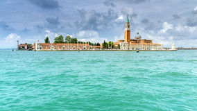 Venetian Island in lagoon. Travel photo: View to the small Island of San Giorgio Maggiore in the lagoon of Venice Stock Image
