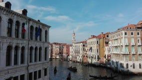 Venetian kanal med gondole i Venedig, Italien Arkivbild