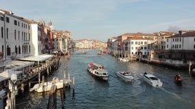 Venetian kanal med gondole och fartyg i Venedig, Italien Royaltyfria Bilder