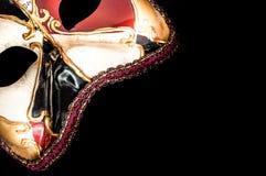 Venetian karnevalmaskering på svart bakgrund Royaltyfria Foton