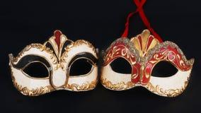 Venetian karnevalmaskeringar på svart bakgrund Royaltyfri Fotografi