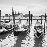 Venetian lagoon with moored gondolas Royalty Free Stock Photos