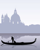 Venetian landscape. Black silhouette of a gondola floating on the calm water of Venetian landscape Royalty Free Stock Photos