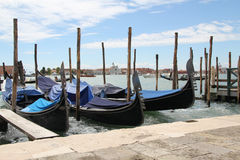 Venetian landscape with gondolas and mooring piles. Stock Photos