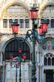 Venetian Lantern. Lanterns in San Marco square. Behind is fragment of St. Mark's basilica. Venice, Italy Royalty Free Stock Photo