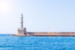 Venetian lighthouse at the harbour entrance, Chania, Crete, Greece, Europe. Stock Photos