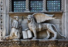 The Venetian lion. And Doge on a cathedral building on San Marco square. Venice. Italy Royalty Free Stock Image