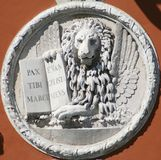 Venetian Lion Sculpture. Lion of Serenissima, the ancient republic of Venice. Latin words mean: Peace for you, Marc,  my evangelist Royalty Free Stock Photo