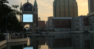 The Venetian in Macao. Macau, China - December 9, 2016: Venetian Casino and luxury mall reflecting in lake at sunset in Cotai Strip. The Venetian Macao is stock video