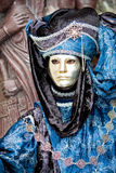 A venetian man in a gold mask. A venetian man in a carnival costume Royalty Free Stock Images