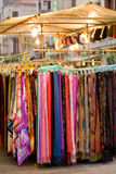 Venetian marketplace. Silk scarves on marketplace in Venice town square royalty free stock images