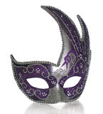 Venetian Mask. A fancy venetian mask shot against a white background with part of it's reflection in front Royalty Free Stock Photos