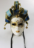 Venetian mask. Beautiful Venetian mask with gold painting and blue fabric and gold embroidery royalty free stock photography