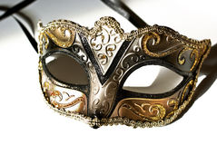 Venetian mask. Mask with golden pattern isolated on white royalty free stock photo