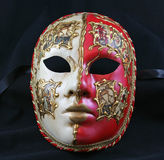 Venetian Mask. Hand painted Venetian Mask against black background stock images