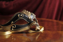 Venetian mask. Beautiful Venetian mask in black and gold Royalty Free Stock Images