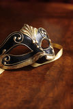 Venetian mask. Beautiful Venetian mask in black and gold Stock Photo