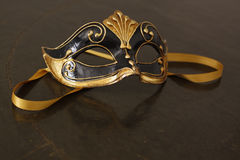 Venetian mask. Beautiful Venetian mask in black and gold Stock Images