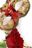 Venetian Mask. An ornate venetian mask with a single red rose Royalty Free Stock Photos