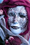 Venetian Mask. And purple scarf Stock Image
