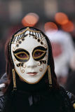 Venetian mask. Venice,Italy,February 26th 2011:Portrait of a person wearing a characteristic masks during the Carnival of Venice nights.The Carnival of Venice ( stock photos