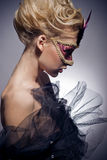 Venetian mask. Beautiful mysterious girl in a Venetian mask Royalty Free Stock Photography
