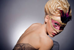 Venetian mask. Beautiful mysterious girl in a Venetian mask Royalty Free Stock Photo