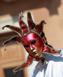 Venetian mask. Image of a red venetian mask with bells Royalty Free Stock Image