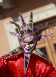 Venetian Mask. Venice,Italy-February 26th, 2011: Image of a colourful Joker mask with bells during the Venice Carnival.The Carnival of Venice (Carnevale di Royalty Free Stock Photo