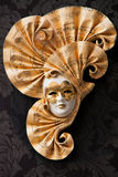 Venetian Mask. Yellow and gold Ventian carnival mask, with music motif swirls Stock Photography