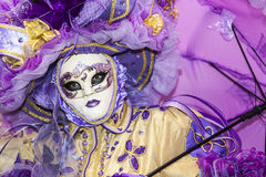 Venetian Mask. Venice,Italy-February 26, 2011: Image of a person disguised in a complex Venetian costume during the Venice Carnival days royalty free stock photo
