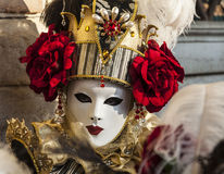 Venetian Mask. Venice, Italy- February 18th, 2012: Portrait of a person wearing a beautiful mask during the Venice Carnival Royalty Free Stock Photos
