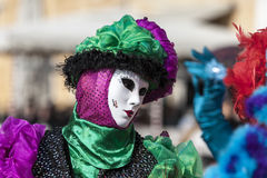 Venetian Mask. Venice, Italy- February 18th, 2012: Portrait of a person in a traditiona mask during the Venice Carnival days Stock Photo