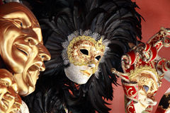 Venetian mask. S with black feathers on a red background