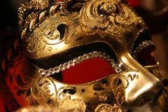 Venetian mask. On red background