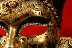 Venetian mask. Ornate handmade venetian mask on red background Stock Photo