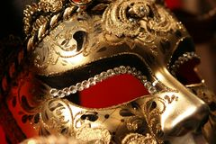 Venetian mask. Ornate handmade venetian mask on red background Stock Image