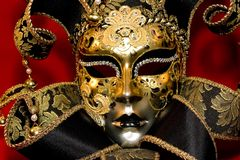 Venetian mask. Ornate handmade venetian mask on red background Royalty Free Stock Images