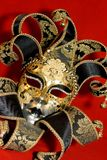 Venetian mask. Ornate handmade venetian mask on red background Stock Photos