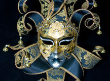 Venetian mask. Great venetian mask lying on black background Stock Photo