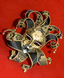 Venetian mask. Ornate venetian mask lying on red background Royalty Free Stock Photography