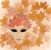 Venetian mask autumn. Venetian mask e-collage : autumn Stock Image
