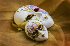 Venetian mask on the background of draping Stock Photo