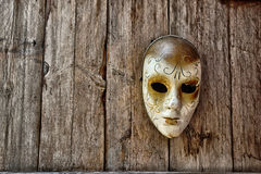 Venetian Mask. In the background of wood Royalty Free Stock Images