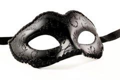 Venetian Mask. Black Venetian Mask (isolated on white royalty free stock image