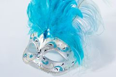Venetian mask. With blue feathers on white Stock Photo